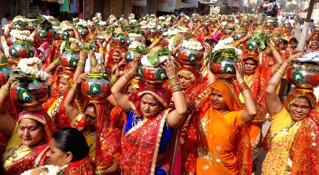 Women participate in 'Kalash Yatra' procession from Shri Krishna Janmabhoomi temple, in Mathura on April 11, 2019.