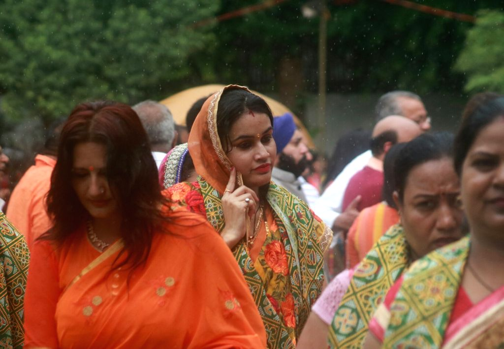 Women participte during a programme organised to celebrate Teej festival at Union Information and Broadcasting Minister Smriti Irani's residence in New Delhi on July 25, 2017. - Smriti Irani