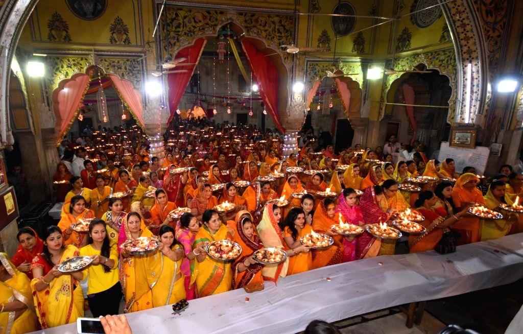 Women perform `aarti`at a Jaipur temple on Rama Navami on April 13, 2019.