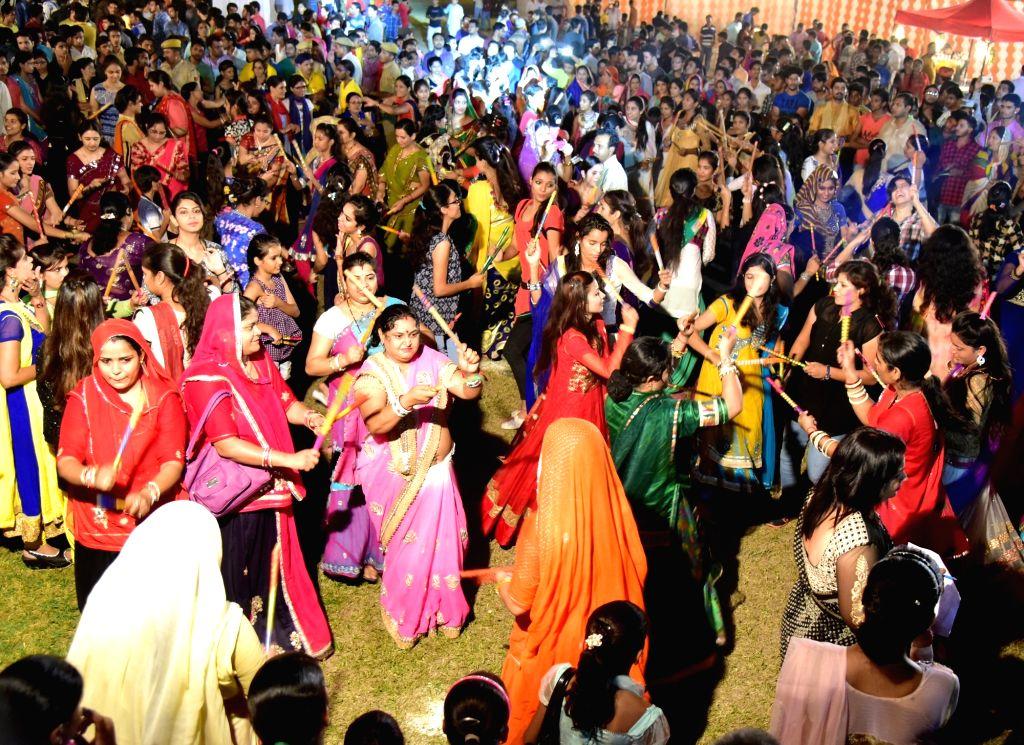 Women perform Dandiya during Navratri in Bikaner of Rajasthan on Oct 7, 2016.
