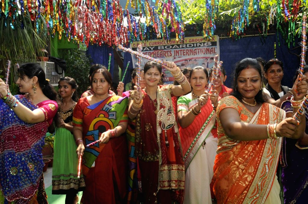 Women perform during a Dandia programme organised on Navratri festival in Patna on Oct 4, 2016.