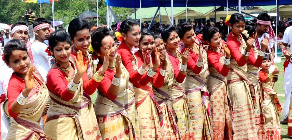 Women perform during the Rongali Bihu celebrations in Guwahati on April 14, 2016.