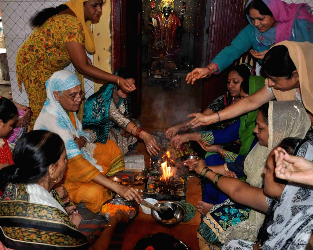 Women perform hawan over the mysterious braid chopping incidents in New Delhi on Aug 5, 2017.