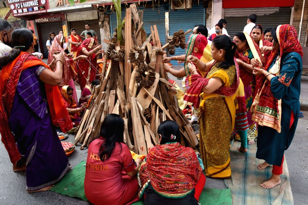 Women perform Holika rituals, a day before Holi festival, in Patna on Sunday March 28,2021.