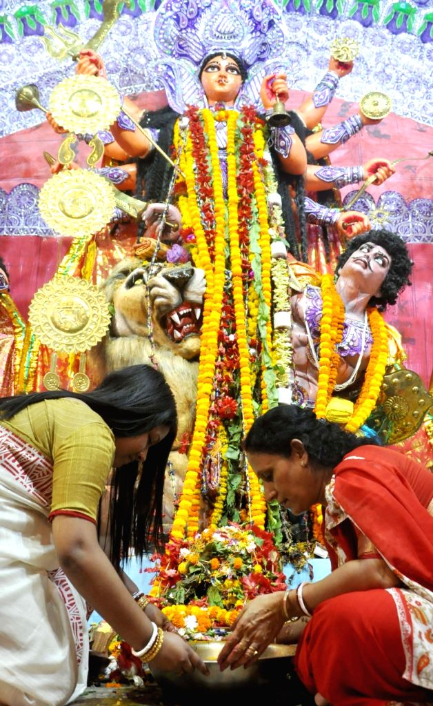 Women perform rituals ahead of the immersion of the idol of Goddess Durga during Vijaya Dashami celebrations in Kolkata, on Oct 8, 2019.