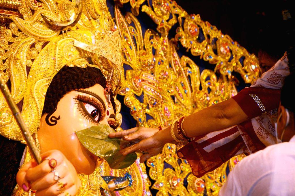 Women perform rituals (Devi Baran) ahead of Durga idol immersion at Ekdalia Evergreen Club community puja pandal, in Kolkata on Oct 27, 2020.
