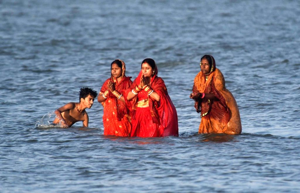 Women perform rituals during Chaiti Chhath celebrations amid countrywide lockdown imposed to contain the spread of novel coronavirus, in Patna on March 30, 2020.
