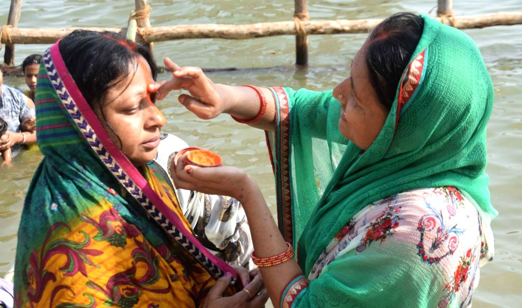 Women perform rituals during Chaiti Chhath Puja celebrations, in Patna on April 10, 2019.