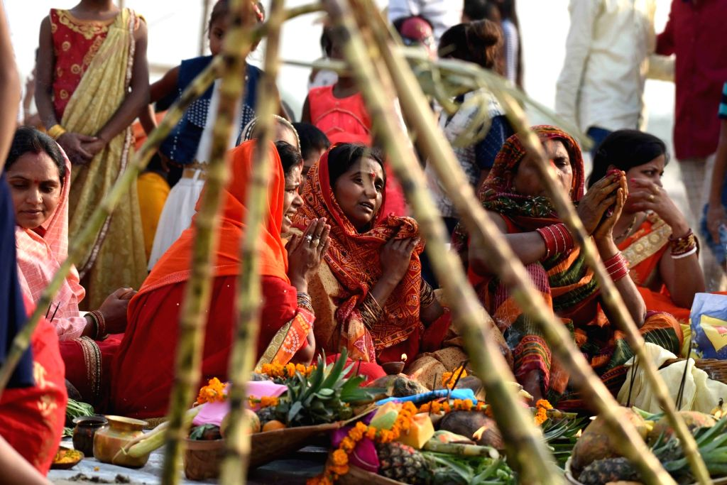 Women perform rituals during Chaiti Chhath Puja celebrations, in Patna on April 11, 2019.