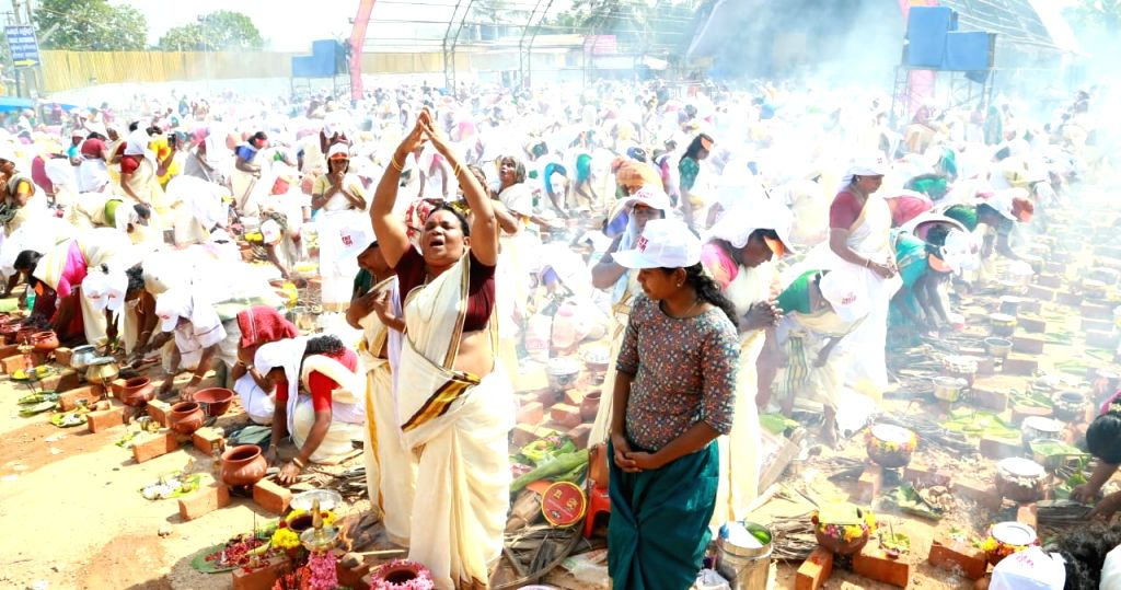 """Women perform rituals during the ongoing """"Attukal Pongala"""" festival at the Attukal Temple, in Thiruvananthapuram, Kerala, on Feb 21, 2019."""