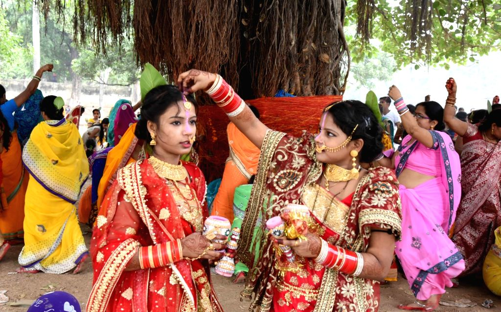Women perform rituals during Vat Savitri Puja in Patna, on June 3, 2019.