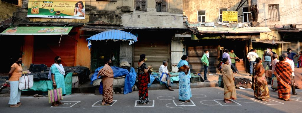 Women practise social distancing as they queue up outside a ration shop in Kolkata's Bowbazar during the 21-day nationwide lockdown imposed as a precautionary measure to contain the spread ...