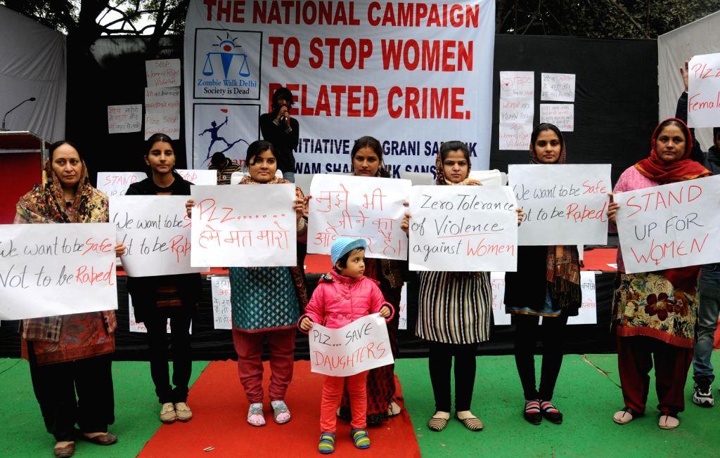 Women protest against violence against women at Jantar Mantar in New Delhi on Dec. 22, 2013.