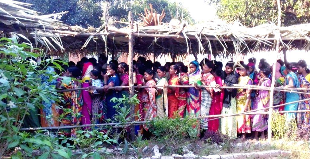 Women queue to cast their vote for Lok Sabha election at Bastar, Chhattisgarh on April 11, 2019.