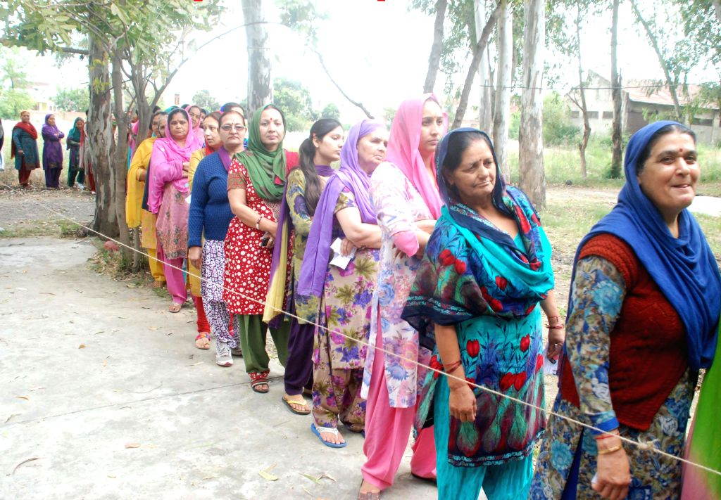 Women queue-up to cast their votes at a polling booth during the fifth phase of 2014 Lok Sabha Polls in Udhampur parliamentary constituency of Jammu and Kashmir on April 17, 2014.