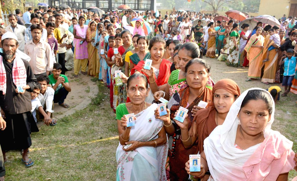 Women queue-up to cast their votes at a polling booth during the sixth phase of 2014 Lok Sabha Polls in Guwahati on April 24, 2014.