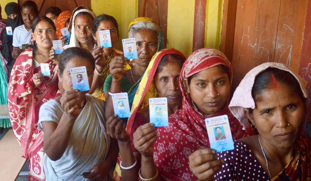 Women queue-up to cast their votes at a polling booth during the sixth phase of 2014 Lok Sabha Polls in Kokrajhar of Assam on April 24, 2014.