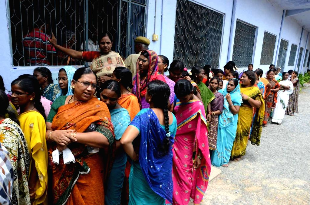 Women queue-up to cast their votes at a polling booth during the eighth phase of 2014 Lok Sabha Polls in Kurnool district of Andhra Pradesh on May 7, 2014.