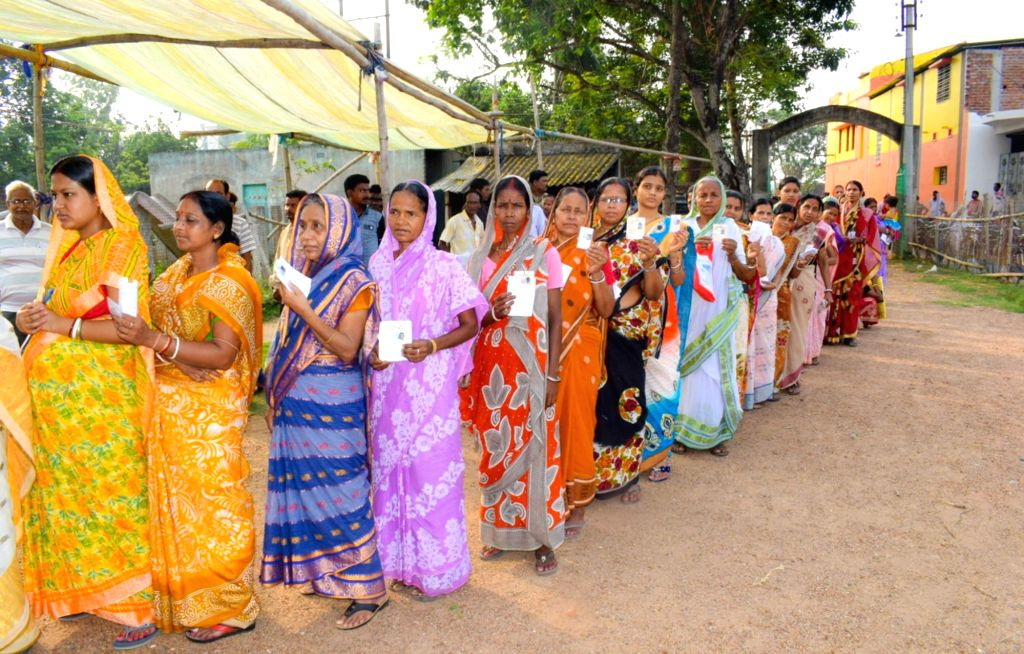 Women queue up to cast their votes during the sixth phase of 2019 Lok Sabha elections, in Bankura, West Bengal on May 12, 2019.