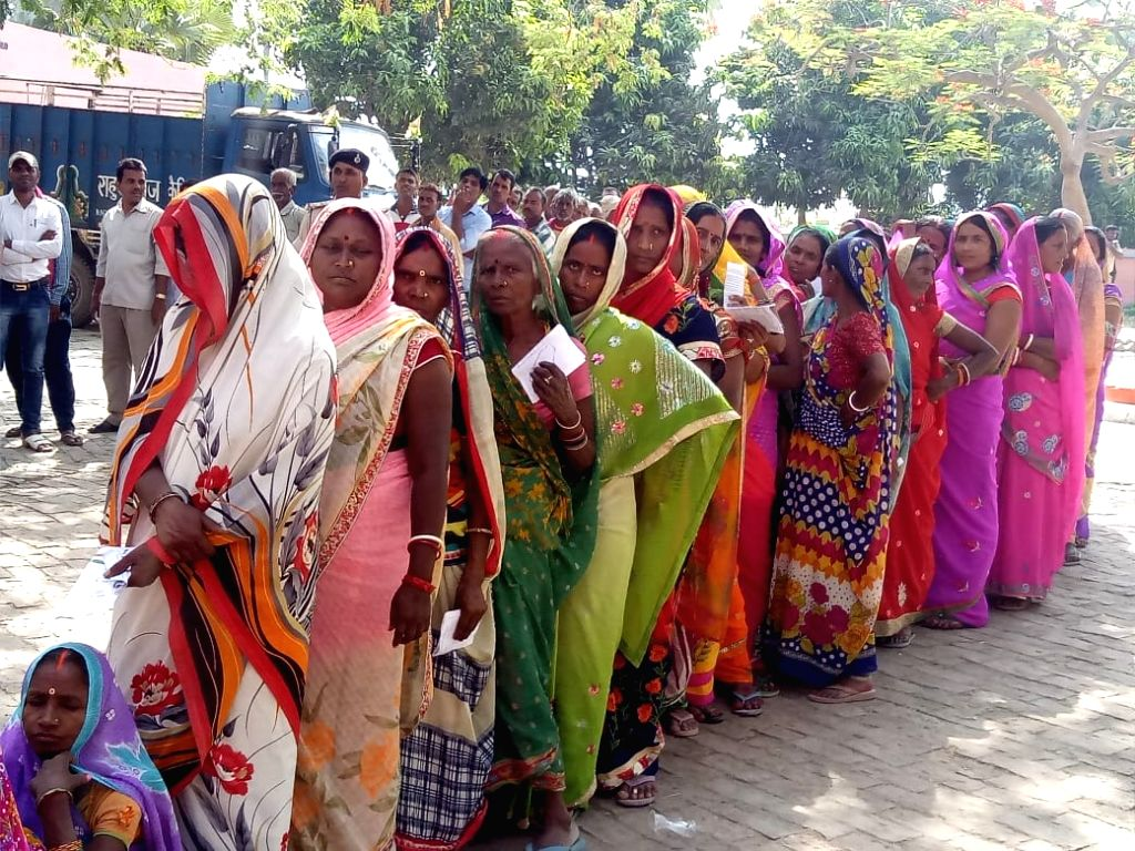 Women queue up to cast their votes during the sixth phase of 2019 Lok Sabha elections, in Bihar's Siwan on May 12, 2019.