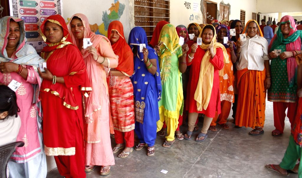 Women queue up to cast their votes during the sixth phase of 2019 Lok Sabha elections, in Gurugram on May 12, 2019.