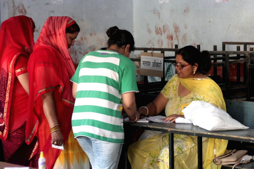 Women register to cast their votes for the first phase of 2019 Lok Sabha elections, in Uttar Pradesh's Ghaziabad, on April 11, 2019.