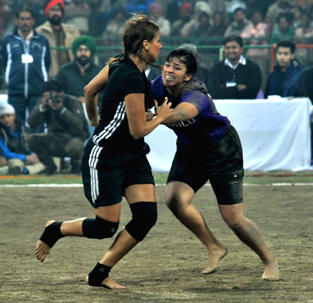 Women`s Kabaddi match between Denmark and Mexico during the 4th Kabaddi World Cup at Guru Nanak Stadium in Amritsar on Dec.6, 2013.