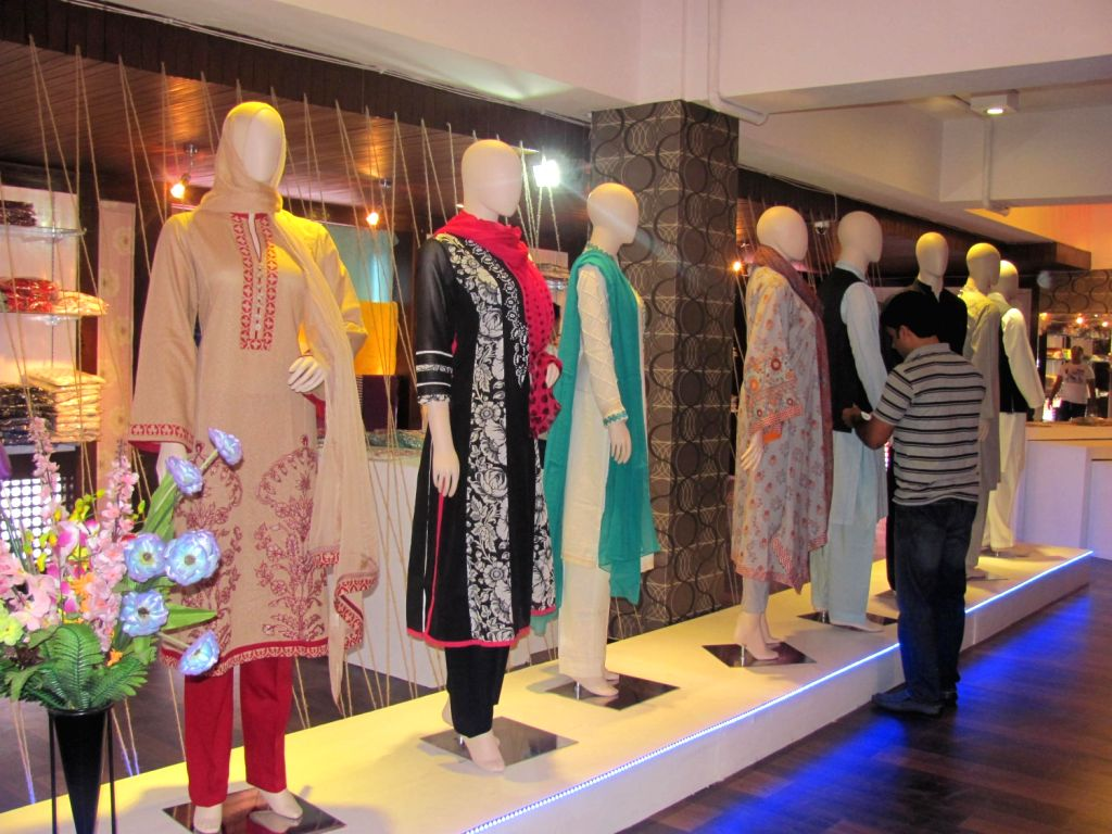 """Women's wear on disply at the """"Tradition of Finesse"""" exhibition of Pakistani designer wear that opened in Srinagar on June 12. (Photo: Raashid Bhat)"""