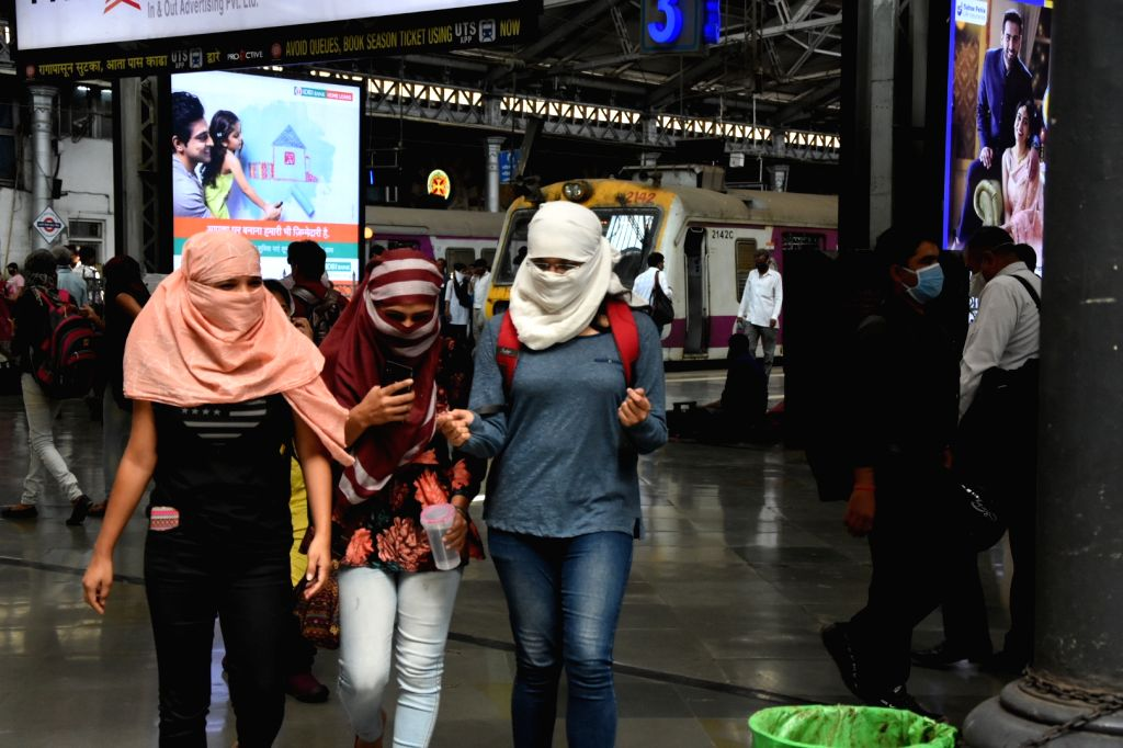 Women seen covering their faces as a measure to contain the spread of COVID-19 (coronavirus), in Mumbai on March 21, 2020.