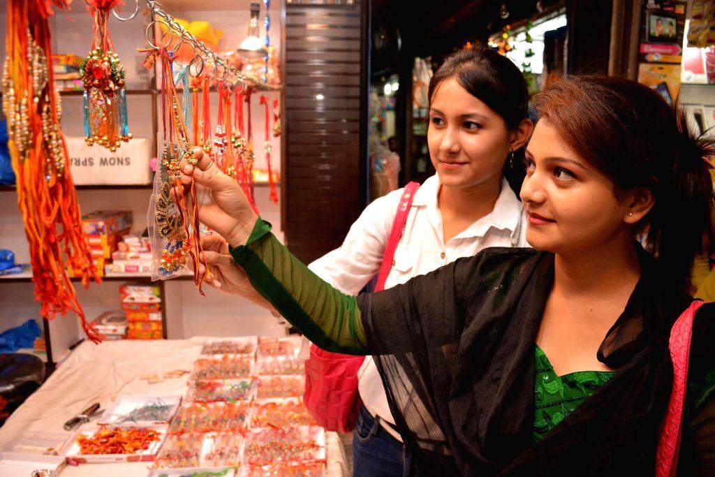 Women selecting rakhi at a market place on the eve of Raksha Bandhan in Guwahati on Aug 9, 2014.