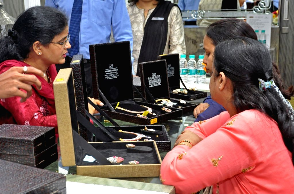 Women shop for jewelry on the occasion of Dhanteras, in Kolkata on Oct 25, 2019.
