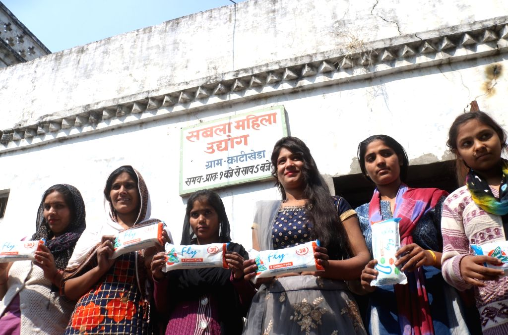 Women show the sanitary pads manufactured at the pad-manufacturing factory in Kathikhera, Hapur, Uttar Pradesh.