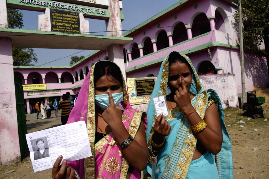 Women show their inked fingers after casting their votes for the first phase of Bihar Assembly elections, at Paliganj in Patna district on Oct 28, 2020.