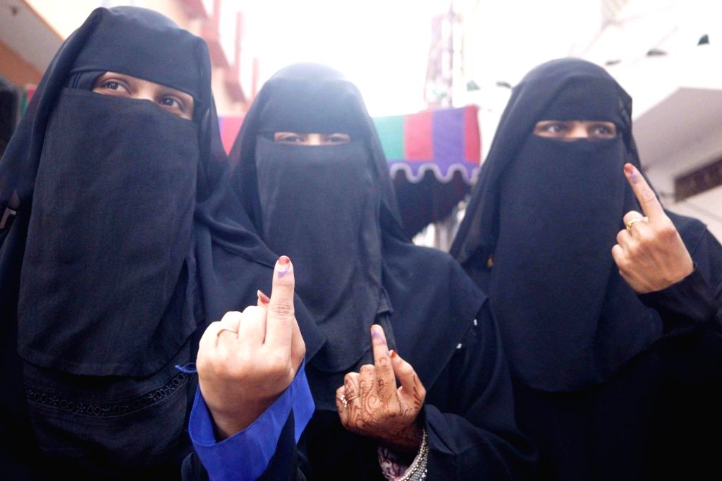 Women show their inked fingers after casting their votes for Telangana Assembly elections in Hyderabad, on Dec 7, 2018.