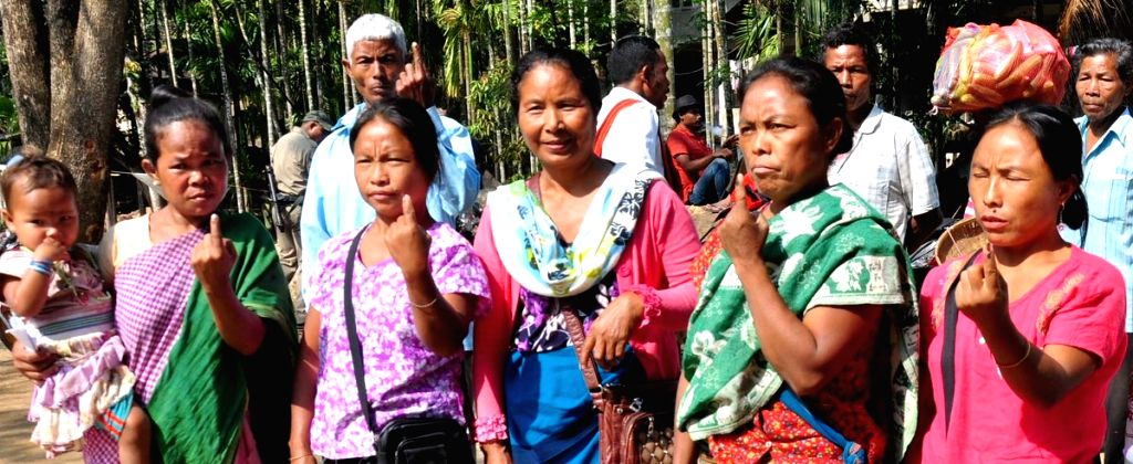Women show their inked fingers after casting their votes for the first phase of 2019 Lok Sabha elections, in Meghalaya's Ri-Bhoi district, on April 11, 2019.