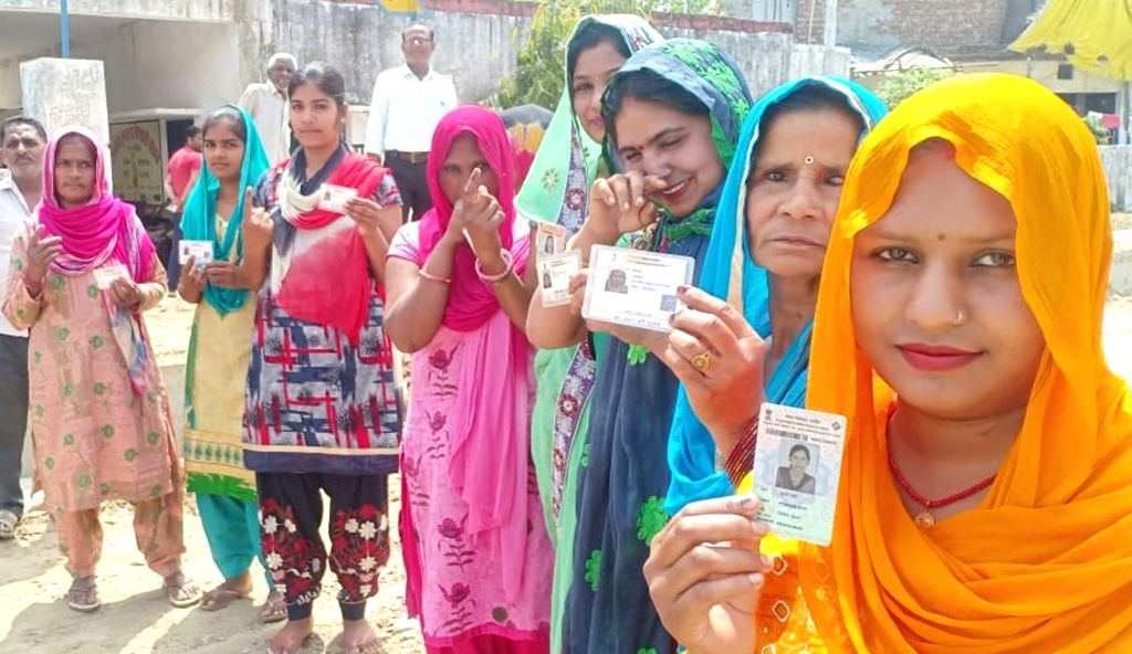 Women show their inked fingers after casting their votes for the first phase of 2019 Lok Sabha elections in Uttar Pradesh's Saharanpur, on April 11, 2019.