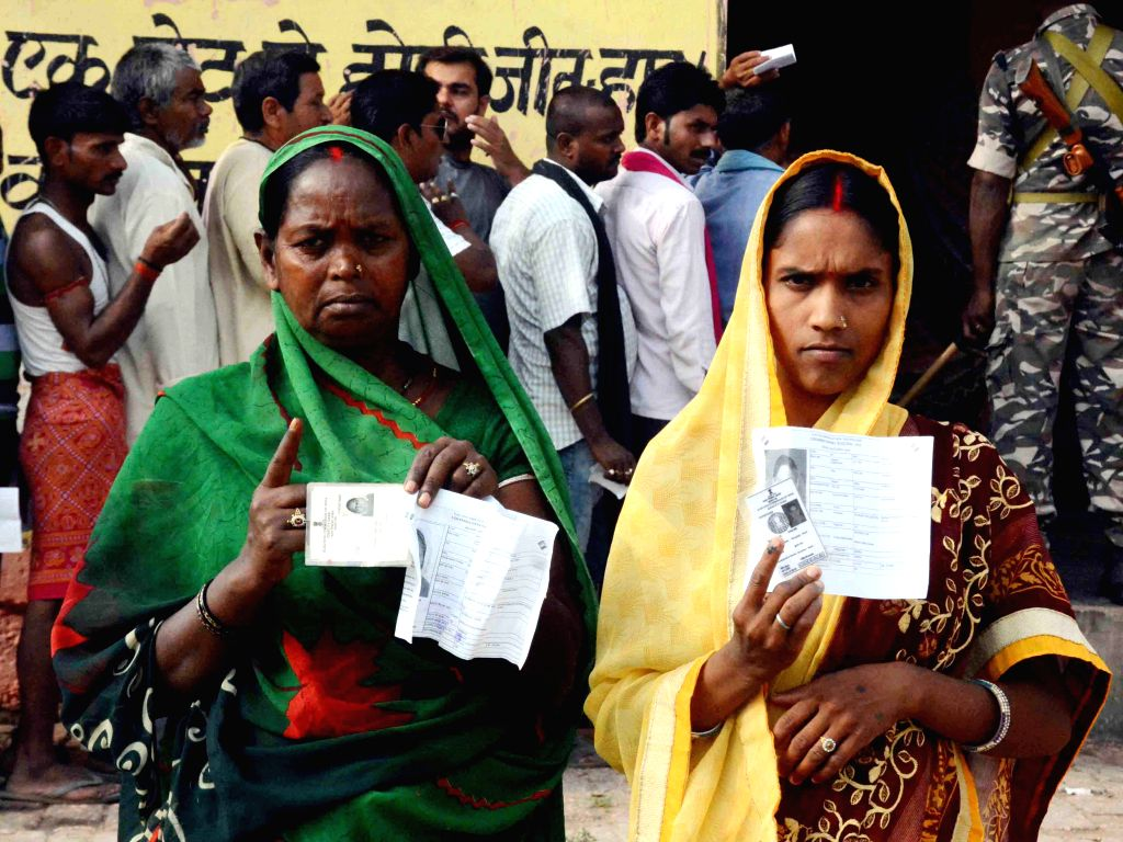 Women show their inked fingers after casting their votes for the fourth phase of 2019 Lok Sabha elections, in Bihar's Munger on April 29, 2019.