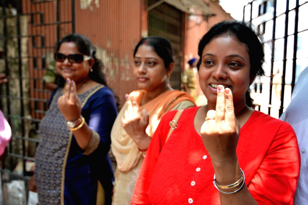 Women show their inked fingers after casting their votes during re-polling at the polling station number 200 of Kolkata's Uttar parliamentary constituency after the Election Commission of ...