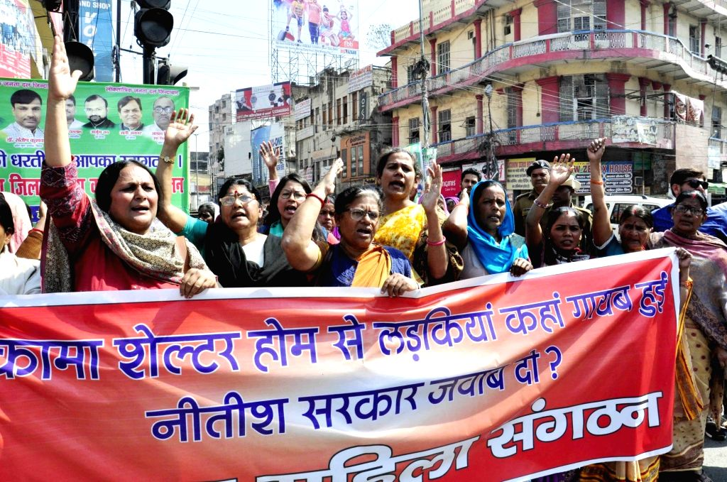 Women stage a demonstration after six of seven girls, fled Mokama shelter home; in Patna on Feb 25, 2019.
