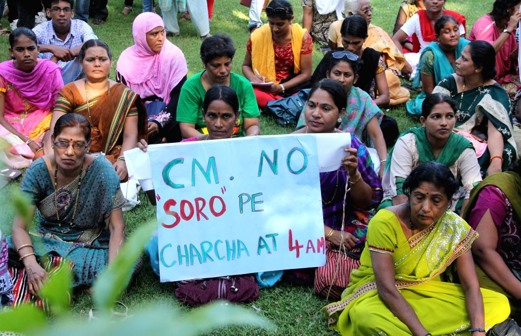 Women stage a demonstration against Goa Government's decision of allowing bars to remain open till 4 AM at Ambedkar Garden in Panaji on May 12, 2014.