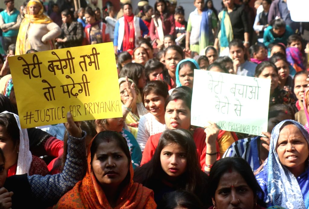 Women stage a demonstration against rising incidents of crime against women, in New Delhi on Dec 3, 2019.