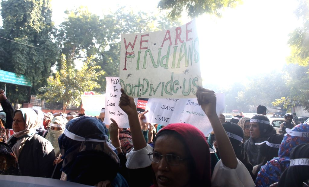 Women stage a demonstration against the Citizenship Amendment Act (CAA) 2019 and National Register of Citizens (NRC), in New Delhi on Jan 11, 2020.