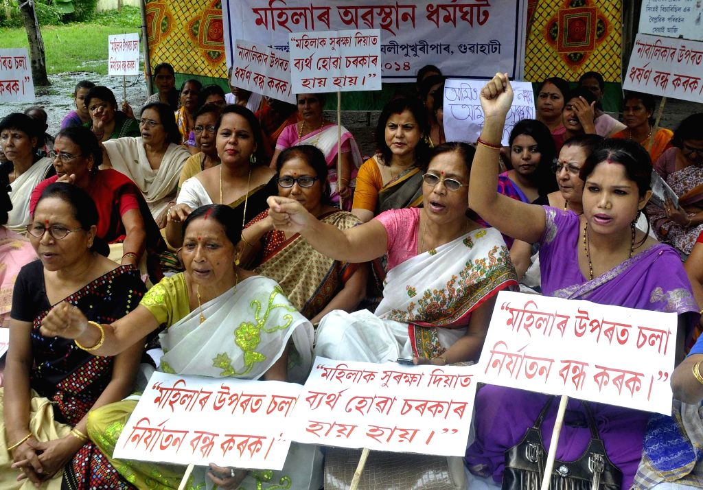 Women stage a demonstration to protest against atrocities on women in Guwahati on Aug 14, 2014.