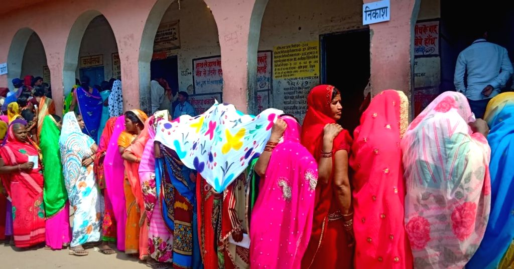 Women stand in a queue to cast their votes for the 2019 Lok Sabha elections in Bihar's Aurangabad, on April 11, 2019.