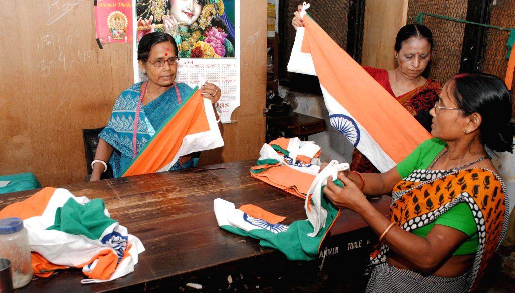 Women stitch national flags ahead of Independence Day at Assam Khadi and Village Industries Board in Guwahati on Aug 7, 2014.