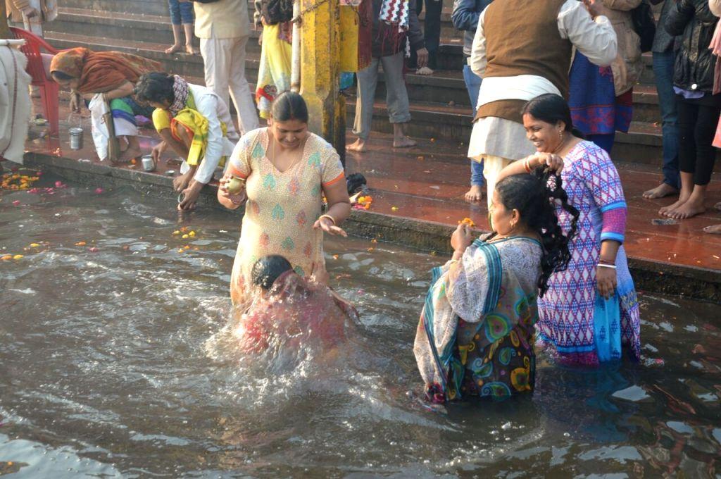 Women take dip in the Yamuna river on Makar Sankranti in Mathura, on Jan 14, 2017.