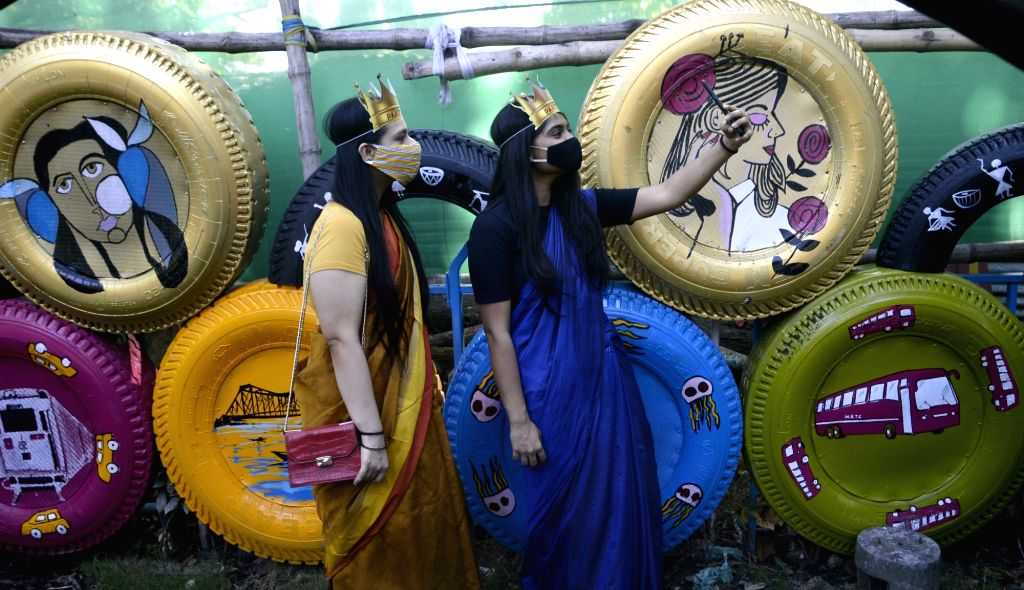 Women taking selfies at the newly inaugurated Tyre Park, in Kolkata on Nov 13, 2019.
