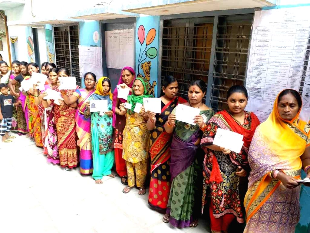 Women wait in a queue to cast their vote for Telangana Assembly elections in Hyderabad, on Dec 7, 2018.