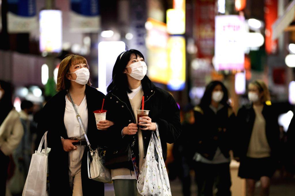 Women walk on a street in Shibuya district. The Japanese government will lift the coronavirus state of emergency on 21 March 2021. Photo: Stanislav Kogiku/SOPA Images via ZUMA Wire/dpa/IANS