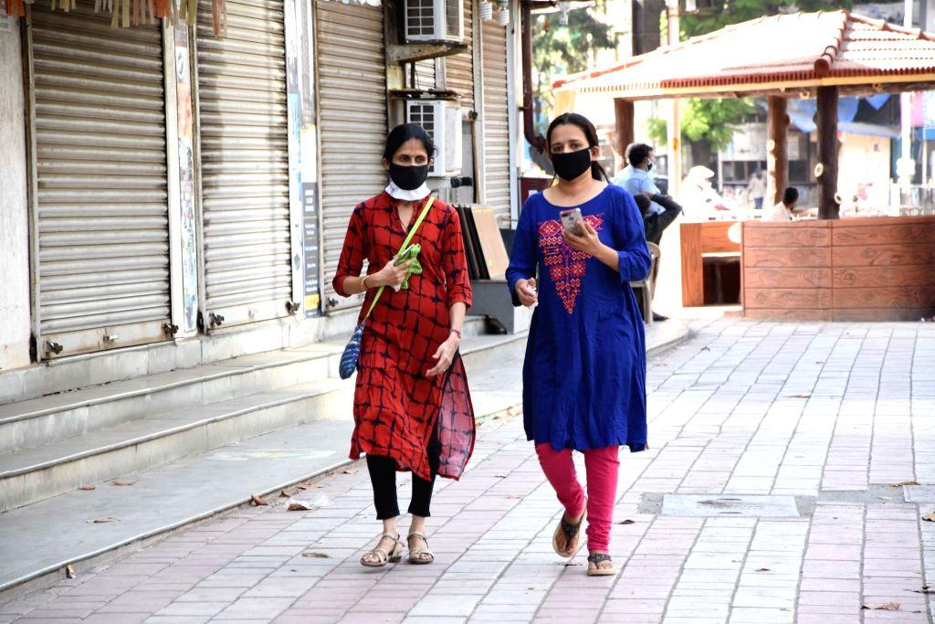 Women wear masks as a precautionary measure against COVID-19 (coronavirus), in Mumbai on March 20, 2020.